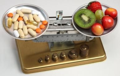 vitamins vs. food on scale
